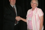 Barbara W. (R) wins Early Lodging Registration prize, presented by Mark S. (L) of NNPS