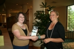 Katerina M. (R) wins GoPro, presented by Ann C. (L) of NNPS