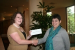 Maria C. (R) wins $250 cash, presented by Ann C. (L) of NNPS