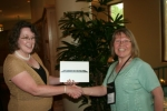 Marti M. (R) wins iPad, presented by Ann C. (L) of NNPS