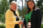 Denise P. (R) - National Nurse Practitioner Symposium Professional Scholarship recipient, congratulated by Ella S. (L) of NNPS