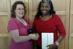 Lakesha T. (R) wins iPad, presented by Ann C. (L) of NNPS