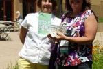 Lisa D. (R) wins $250 cash, congratulated by Brenda D. (L) of NNPS